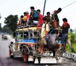 A Jeepney from the Philippines overflowwing with passengers